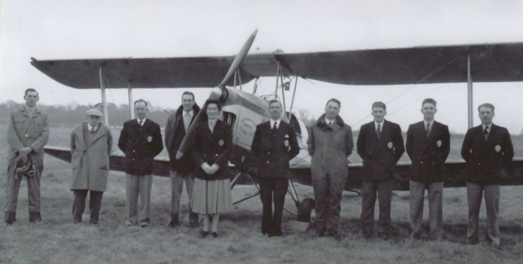 Members of the first Hertfordshire Police Flying Club with their Tiger Moth. From L to R: Sgt John Halsey, UNKNOWN, Pc William James, Ken Green (only surviving member of the club), WPC Audrey Archer, Insp Tom Windsor, Pc Fred Bowen, Pc Norman Bangs, Pc Stan Leathers, Pc George Edmonds. | Ken Green