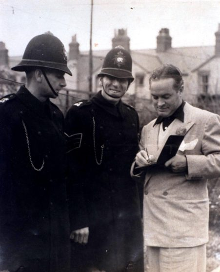 Comedienne  Bob Hope signs an autograph for Sergeant 102 Edgar Street and War Reserve Constable J. Cannon during a vist on 22nd November 1947 to see his grandfather who lived in Bearton Road Hitchin.